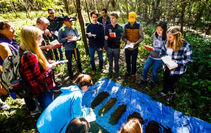 Members of the Sustainability Living Learning Community talk about the results of their research during a soils lab at Hidden Falls Park.
