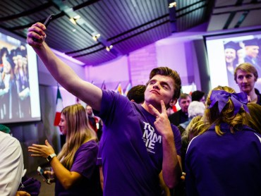 A student takes a selfie during the brand launch event.