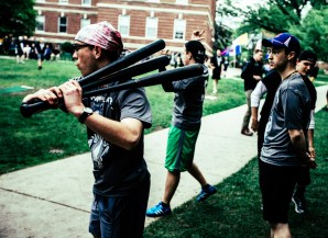 Aaron Hietpas warms up with a fistful of plastic bats.