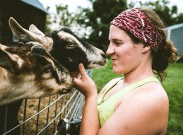 Rebekka Schrank puts in some quality time with the goats.