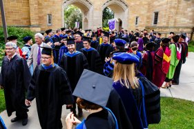 New faculty receive applause as they walk past The Arches at the academic convocation procession