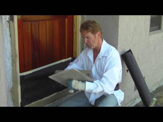 Patching plaster around a new front door.
