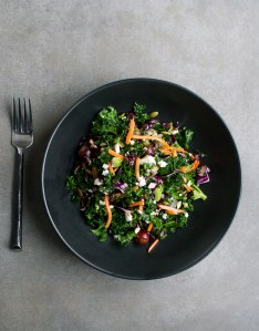 photograph of a detox salad in a black bowl.