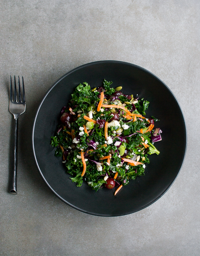 photograph of a detox salad in a black bowl.