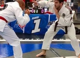 Brown belt in jiu jitsu competing in tournament