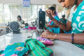 Sowing re-usable plastic-free Menstrual Pads in Auroville.