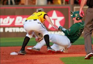 A Southern Miss Infielder tags out a UAB runner during the conference series played against the Blazers this weekend at Pete Taylor Park. Courtesy of University Communications