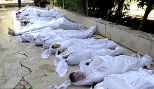 """This citizen journalism image provided by the Local Committee of Arbeen shows dead bodies of Syrian citizens in Arbeen town, Damascus, Syria, Wednesday, Aug. 21, 2013. Syrian regime forces fired intense artillery and rocket barrages Wednesday on the eastern suburbs of the capital Damascus, in what two pro-opposition groups claimed was a """"poisonous gas"""" attack that killed dozens of people.  Photo from Local Committee of Arbeen"""