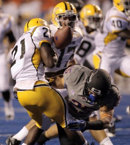 USM running back Jeremy Hester fumbles after a hit by Boise St. linebacker Christopher Santini on a kick off return against the Broncos at Bronco Stadium. Brian Losness/USPresswire