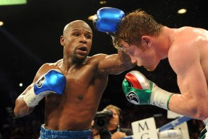 Floyd Mayweather Jr., left, and Canelo Alvarez battle during their WBC and WBA super welterweight title fight at MGM Grand Garden Arena in Las Vegas Saturday night.   Jayne Kamin-Oncea-USA TODAY Sports