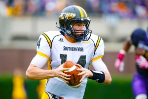 Golden Eagles quarterback Nick Mullens carries the ball against the East Carolina Pirates at Dowdy-Ficklen Stadium. East Carolina Pirates defeated Southern Miss Golden Eagles 55-14.  James Guillory/USASI