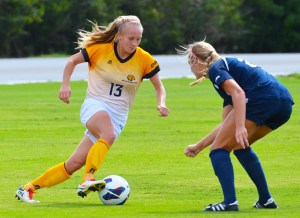 Freshman midfielder Sommer Jones dribbles the ball past a Rice defender during their game on Saturday. The Eagles fell short losing the game 3-0. Michael Kavitz/Printz