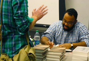 Kevin Young signs copies of his book after his poetry reading in the International Center on Oct. 2. Michael Kavitz/Printz