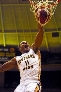 Senior forward Daveon Boardingham slam dunks for two of the Golden Eagles' 61 points scored against Jackson State Nov. 8.  Zachary Odom/Printz