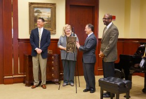 Cory Callies, left, and Lori Lewis, left center, from Kawai America present Southern Mississippi's School of Music Director Michael Miles and university president Rodney Bennett with the EPIC award Oct. 30. Lonnie Young/Courtesy Photo