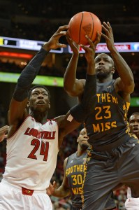 Louisville Cardinals forward Montrezl Harrell battles Southern Miss Golden Eagles guard Jerrold Brooks for a rebound during the second half at KFC Yum! Center. Louisville defeated Southern Miss 69-38.   Jamie Rhodes / USA Today Sports Images
