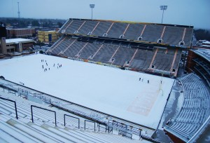 Students play on the snow-white turf at M.M. Roberts Stadium Tuesday, Jan. 28, after the winter storm Leon hovered over South Mississippi dumping about an inch of snow and sleet.  Susan Broadbridge / Printz