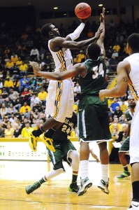 Junior guard Chip Armelin attempts a dunk at the basketball game against Tulane Saturday night. Becky Vu/Printz