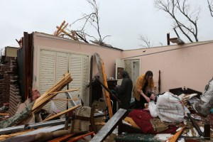 Michael and Shannon Pierce salvage valuables from their parent's bedroom after the tornado Feb. 10, 2013. Courtesy photo