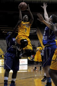 Southern Miss Senior Jamierra Faulkner puts up a layup shot, despite the efforts of the Middle Tennessee defenders. A.J. Stewart/Printz