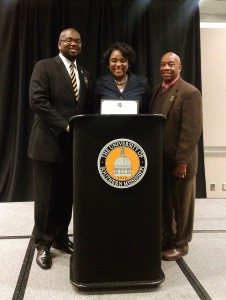 Kristen Dupard, winner of the Lampkin-Hughes Oratorical contest, stands at the podium with her award.  Courtesy photo