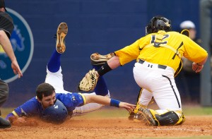 USM catcher Matt Durst tags out McNeese State's Reed Gordy at home in the bottom of the fifth inning Sunday. Rick Hickman/Lake Charles American Press