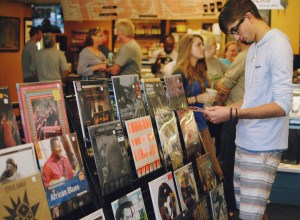 Jacob Lagasse strolls around T-Bones Records & Cafe looking at the variety of albums on National Record Store Day Saturday afternoon, April 19.  Becky Vu/Printz