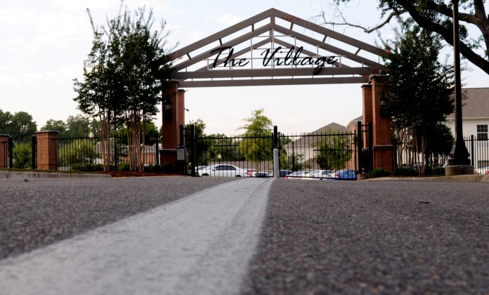 The Village gates that encloses the seven sorority houses remains closed until hundreds of girls run to their new homes on Girl's Bid Day, September 9th. | Photo by Susan Broadbridge