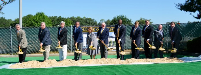 Members of the foundation, President Bennett, Dean Nugent and others take part in the ground breaking celebration of Asbury Hall Wednesday morning.  The new building will be for the College of Health located next to the Dance and Theater building.- Mary Sergeant