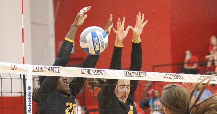 Junior Lydia Bonner and Senior Jasmine Crowell go for a block as the lady eagles play against Louisiana Techh Monday in Ruston, La.  Southern Miss wins 3-0. -Courtesy Photo