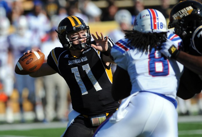 Southern Miss' second string quarterback Cole Weeks passes against LA Tech's defense during the Saturday afternoon game in Hattiesburg, MS.  The Eagle's fall to the Bulldogs, 31-20.  -Susan Broadbridge