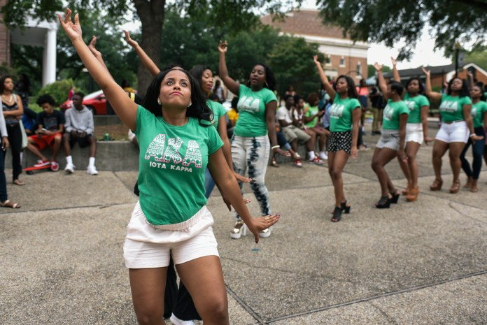 Asia Haynes leads the Iota Kappa chapter of Alpha Kappa Alpha Fraternity, Inc in a stroll at Coolin' With the Zetas back to school social, Wednesday August 19, 2015, which is the first NPHC event held this 2015-16 school year. Courtland Wells/ Student Printz