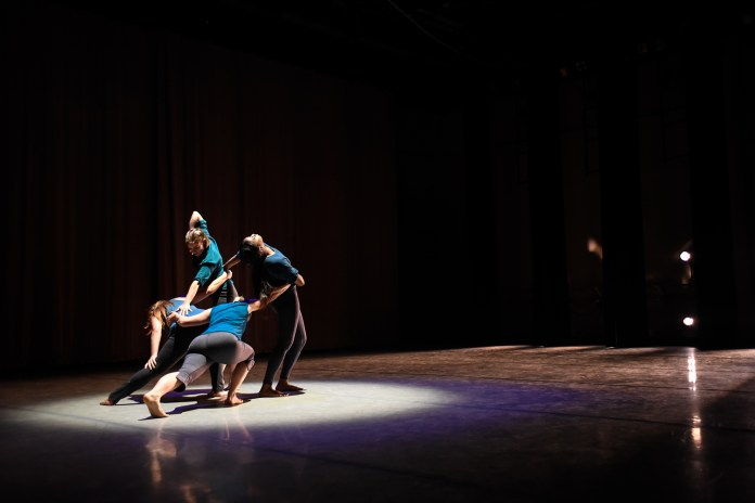 Dancers dance in 'tread away' choreographed by Taylor Krupp during the Hub Dance Collective's 'In The Groove' presented on Friday, August 21, 2015. This was the third annual Hub Dance Collective concert.