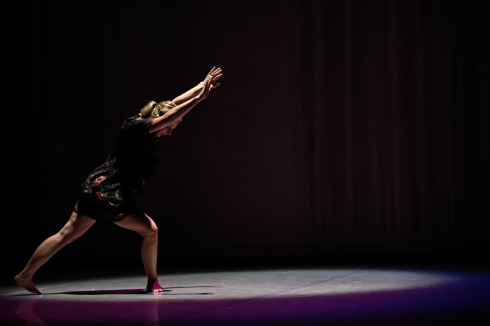 Kelly Ferris Lester dances in 'In Her Clothes' during the Hub Dance Collective's 'In The Groove' presented on Friday, August 21, 2015. This was the third annual Hub Dance Collective concert.