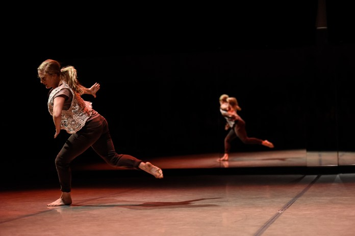Taylor Krupp dances in 'Anssemble the Emsemble' choreographed by Stacy Reischman Fletcher during the Hub Dance Collective's 'In The Groove' presented on Friday, August 21, 2015. This was the third annual Hub Dance Collective concert.