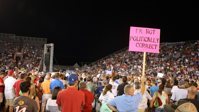 A member of the audience holding a homemade sign for Trump at the Ladd-Peebles Stadium in Mobile, Alabama August 21, 2015