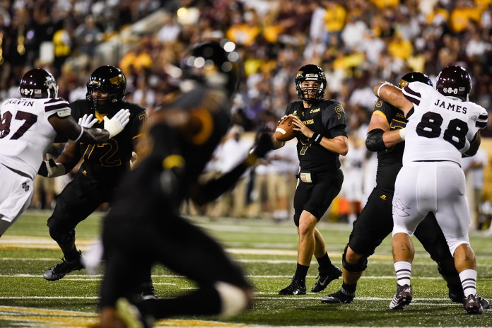 Quarterback Nick Mullens prepares to throw to a receiver in the season opener against Mississippi State on September 5, 2015. Courtland Wells/Student Printz