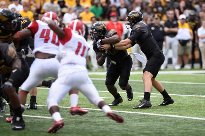 Jalen Richard(30) takes a handoff from Nick Mullens against Austin Peay. The Golden Eagles won against the Governors 52-6 Sept 12, 2015.