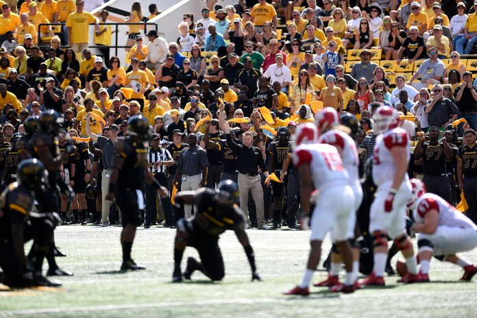 The Golden Eagles on the side line get the players on the field pumped up for the next play against Austin Peay. The Golden Eagles won against the Governors 52-6 Sept 12, 2015.