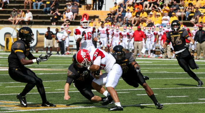 Defenders attempt a tackle during the game against Austin Peay. The Golden Eagles won 52-6 against the Governors Sept 12, 2015.