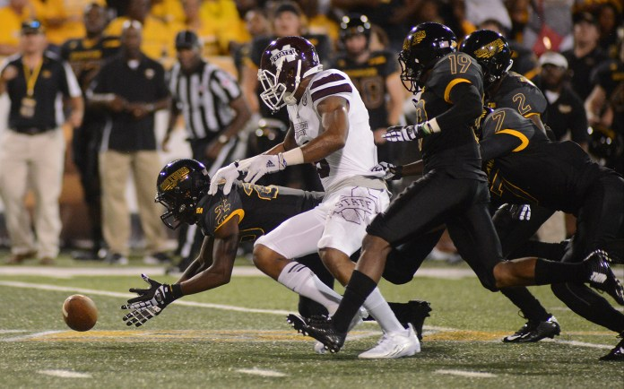 Southern Miss running back Ito Smith reaches for a loose ball during the game played against Mississippi State in Hattiesburg on Saturday night.  Mary Alice Weeks/Student Printz