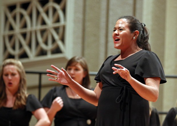"""The Southern Miss Showcase Concert of the Southern Invitational Choral Conference 2015 was held at Bennett Auditorium on the USM campus Monday, September 28, 2015.  Ana Ruth Cortes, of the Southern Belle Tones, sings """"Break Free."""" Fadi Shahin/Student Printz"""