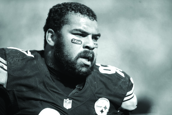 Oct 18, 2015; Pittsburgh, PA, USA; Pittsburgh Steelers defensive end Cameron Heyward (97) on the sidelines against the Arizona Cardinals during the second quarter at Heinz Field. Hayward was fined last week for wearing a tribute to his father on his eye black. Mandatory Credit: Charles LeClaire-USA TODAY Sports