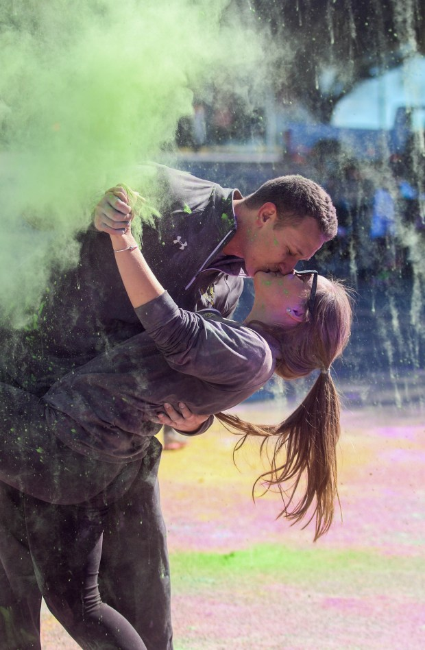 Participants of the Burnn' love 5K throw color powder into the air after the race finished on Saturday, Feb. 13. Fadi Shahin/Assistant Photo Editor