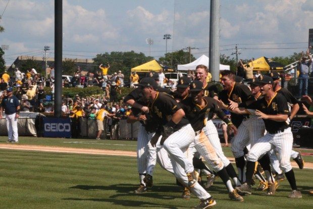 The Southern Miss baseball team runs out onto the field to celebrate their 3-2 victory over Rice in the C-USA baseball tournament on May 29.