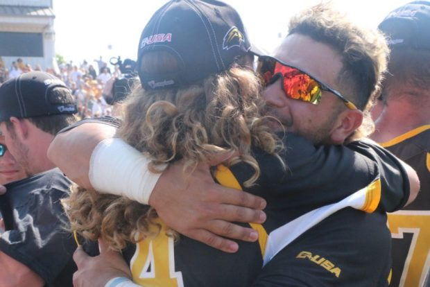 Chase Scott and Cord Cockrell embrace each other after their 3-2 victory over Rice on May 29.