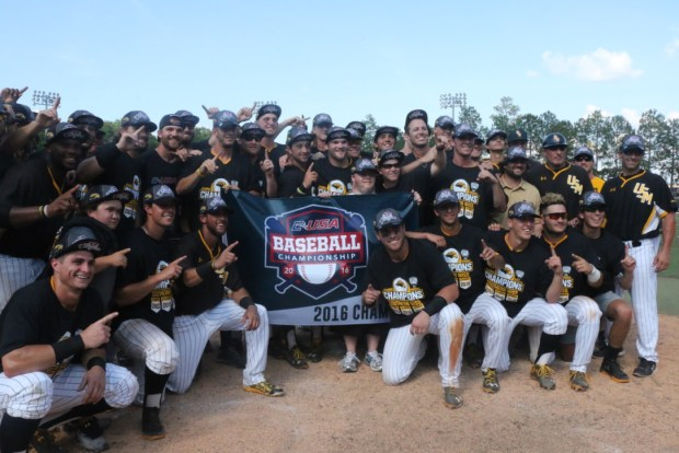 The Golden Eagles pose for a picture with their championship banner after winning the C-USA championship crown.