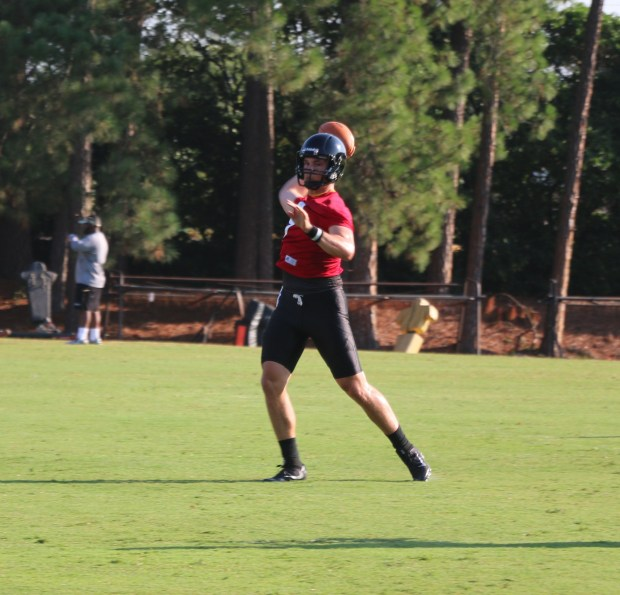 Senior quarterback Nick Mullens attempts a pass during practice on August 14.