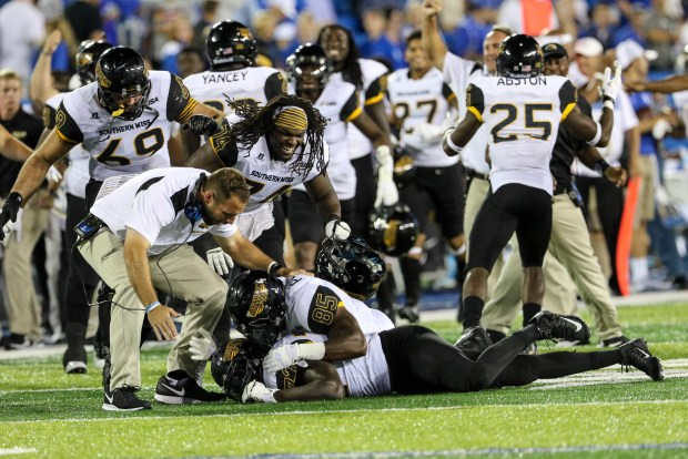 Southern Miss players celebrate after defensive lineman Xavier Thigpen recovers a fumble against the Kentucky Wildcats in Lexington, Kentucky on September 3, 2016. (Student Printz/ Hunt Mercier)