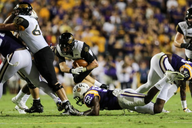 Southern Miss quarterback Nick Mullens (9) jumps over Kendell Blackwith (52) to gain a first down against LSU in Baton Rouge, Louisiana on Oct. 15, 2016. (Student Printz/ Hunt Mercier)
